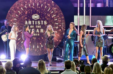 Maddie Marlow and Tae Dye of musical duo Maddie and Tae, Carrie Underwood, Hannah Mulholland, Naomi Cooke and Jennifer Wayne of musical group Runaway June perform onstage during the 2018 CMT Artists of The Year at Schermerhorn Symphony Center on October 1