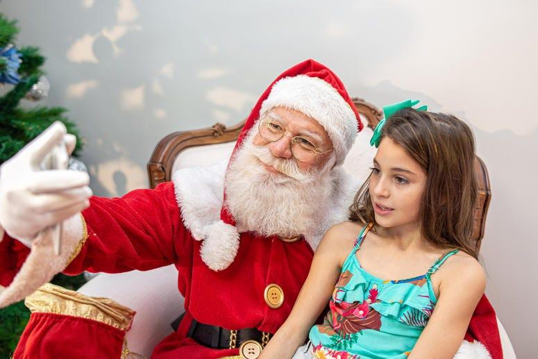 Santa taking selfie with child