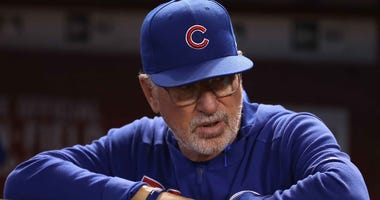 Chicago Cubs manager Joe Maddon looks on from the dugout.