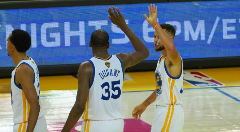 Golden State Warriors forward Kevin Durant (35) celebrates with guard Stephen Curry (30) in the second half of the 2017 NBA Finals at Oracle Arena.