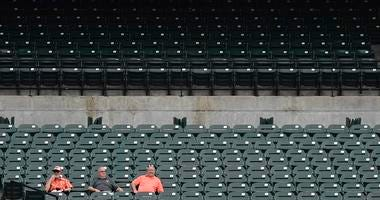 Few fans show up to watch an Orioles game at Camden Yards.