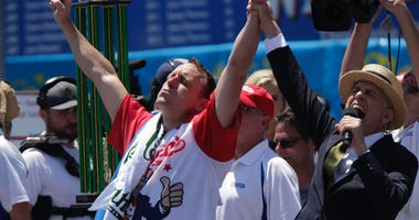 13-Time Nathan's Champ Joey Chestnut Eats Record 75 Hot Dogs in 10 Minutes