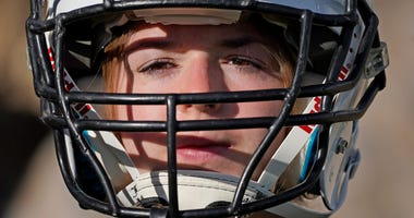 Female football star sues for schools to offer girls' teams