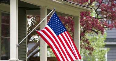 American Flag Hangs Outside a Home - Getty Images