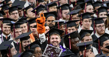 Former Tiger Cub mascot Nicholas Tourville of Fort Mill, Bachelor of Science in Bioengineering, points up with a tiger cub glove during Clemson University Fall graduation at Littlejohn Coliseum in Clemson Thursday, December 19, 2019. Clemson University Fa