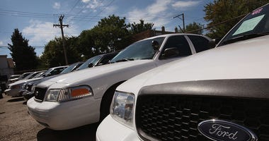 Ford Crown Victorias, once used as police cars