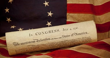 USA Declaration of Independence Lying on Betsy Ross Flag - stock photo