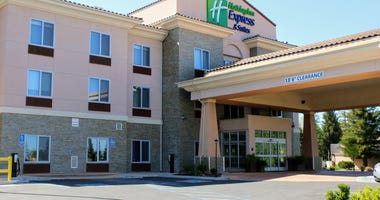 Holiday Inn Express & Suites is one of several hotels with mostly empty parking lots on Hilltop Drive in Redding on Thursday, April 23, 2020. Holiday Inn Express & Suites Redding