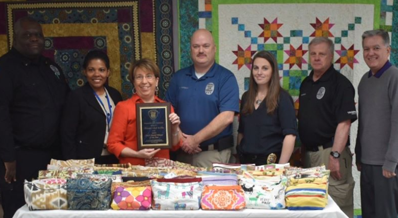 Quilt & Sew receives Chief's Award Winner of the Year.  Photo: L-R, Simpsonville PD Lt. Timmie L. Williams, Victims Advocate Milena Banquez, Quilt & Sew co-owner Marietta Louk, Chief Mike Hanshaw, Cpt. Cheryl Manley, Lt Russ Holthaus and Mayor Shewmaker