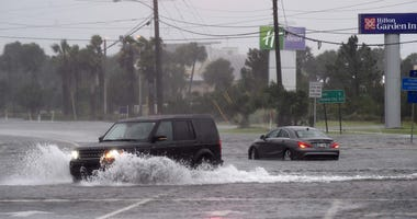 An SUV passes a stalled vehicle in the intersection of U.S. Highway 98 and Santa Rosa Boulevard on Okaloosa Island on Wednesday morning as wind and rain from Hurricane Sally pounded the Emerald Coast. Hurricane Sally