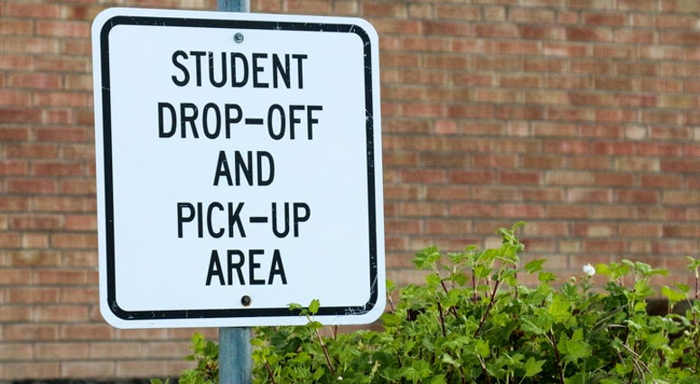 School Drop-Off and Pick-Up Sign - Getty Images