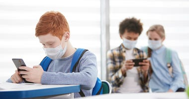 Students with Masks - Getty Images
