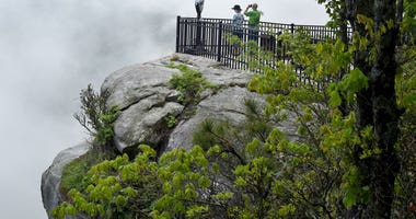 People take in the view of Table Rock from an observation deck at Caesers Head State Park. 1018 Tg Outdoor 6