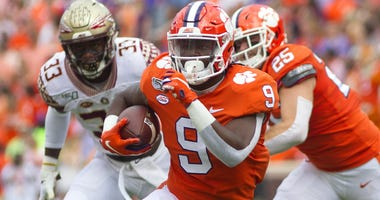 Clemson Tigers running back Travis Etienne (9) carries the ball during the first quarter of the game against the Florida State Seminoles at Clemson Memorial Stadium.