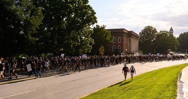 About 3,000 people participate in a protest and march at Clemson's Bowman Field led by members of the university's football team Saturday, June 13, 2020.