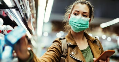 Woman Wears Mask While Shopping During COVID-19 Pandemic