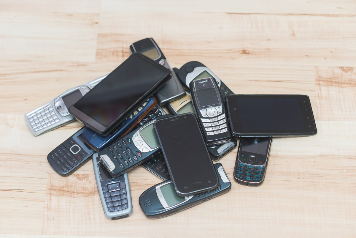 pile of old cellphones