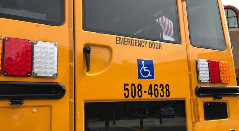 Rear Door of Bus - Emily Gill