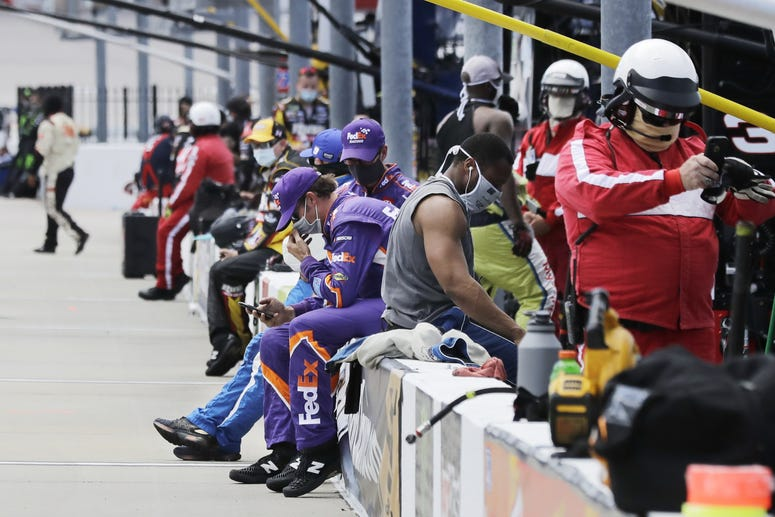 May 17, 2020, Darlington, SC, USA; Crew members and officials wait in the pit area before the start of the NASCAR Cup Series auto race.