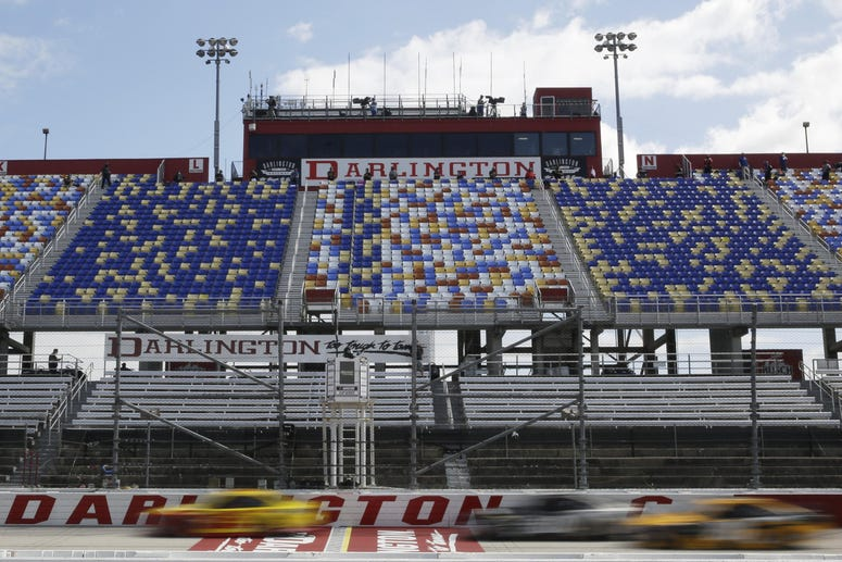 May 17, 2020, Darlington, SC, USA; Cars pass by empty seats during the NASCAR Cup Series auto race.