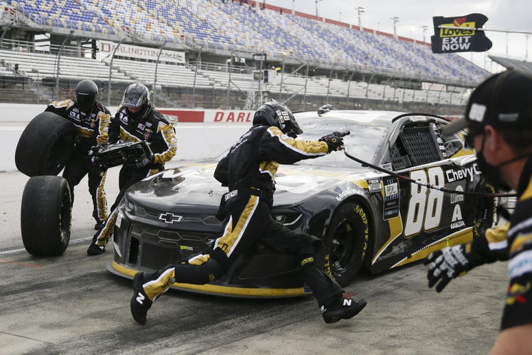 May 17, 2020, Darlington, SC, USA; Alex Bowman (88) makes a pit stop during the NASCAR Cup Series auto race races during the Real Heroes 400 at Darlington Raceway.