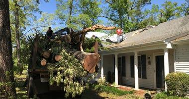 Workers Remove Debris Off Home in Seneca