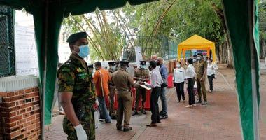 Rajapaksa brothers win by landslide in Sri Lanka's election