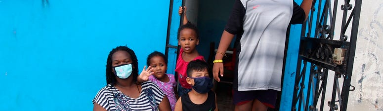 Once in crisis, Ecuador city now helps others battle virus