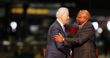 Vice President Joe Biden is greeted by Congressman James Clyburn during his visit to Owen Steel on Wednesday, Feb. 18, 2015 in Columbia, S.C.