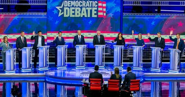 Democratic presidential candidates on stage during the second night of the first Democratic presidential debate on Thursday, June 27, 2019, at the Arsht Center for the Performing Arts in Miami.
