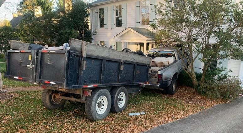 Truck rolls into home, no one hurt.