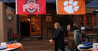 Christy Fletcher of Atlanta, working for Anthony Travel decorated for Clemson football fans who would attend the evening party at The Tortilla Factory in Scottsdale, Arizona Thursday December 26, 2019. Clemson Fans Fiesta Bowl
