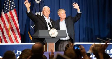 Vice President Mike Pence (left) and Sen. Lindsey Graham wave to the crowd gathered in the Greenville Marriott Saturday, Mar. 30, 2019 after speaking at Senator Lindsey Graham s Upstate Kickoff Reception.