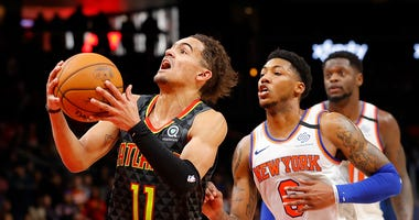 Trae Young drives to the hoop against the New York Knicks