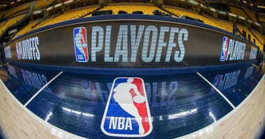 Apr 27, 2018; Indianapolis, IN, USA; A general view of the NBA logo and the playoffs scorer table before game six between the Indiana Pacers and the Cleveland Cavaliers in the first round of the 2018 NBA Playoffs at Bankers Life Fieldhouse. Mandatory Cred