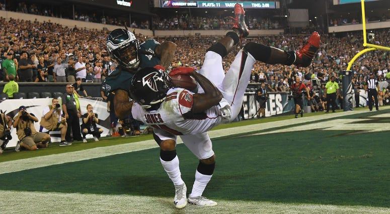 Philadelphia Eagles cornerback Ronald Darby pushes Atlanta Falcons wide receiver Julio Jones out of bounds