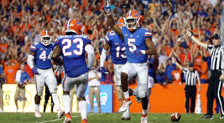 Sep 8, 2018; Gainesville, FL, USA; Florida Gators defensive back CJ Henderson (5) celebrates as he intercepted the ball during the second quarter against the Kentucky Wildcats at Ben Hill Griffin Stadium. Mandatory Credit: Kim Klement-USA TODAY Sports