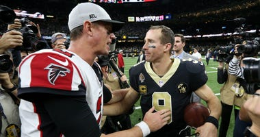 Nov 22, 2018; New Orleans, LA, USA; Atlanta Falcons quarterback Matt Ryan (2) and New Orleans Saints quarterback Drew Brees (9) talk after their game at the Mercedes-Benz Superdome. Mandatory Credit: Chuck Cook-USA TODAY Sports