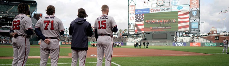 May 20, 2019; San Francisco, CA, USA; Atlanta Braves starting pitcher Touki Toussaint (62) and relief pitcher Jacob Webb ()71 and shortstop Charlie Culberson (second from right) and starting pitcher Sean Newcomb (15) stand for the National Anthem before a