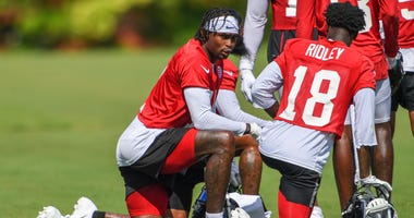 Jul 22, 2019; Flowery Branch, GA, USA; Atlanta Falcons wide receiver Julio Jones (11) talks to wide receiver Calvin Ridley (18) on the field during the first day of training camp at Falcons Training Complex. Mandatory Credit: Dale Zanine-USA TODAY Sports