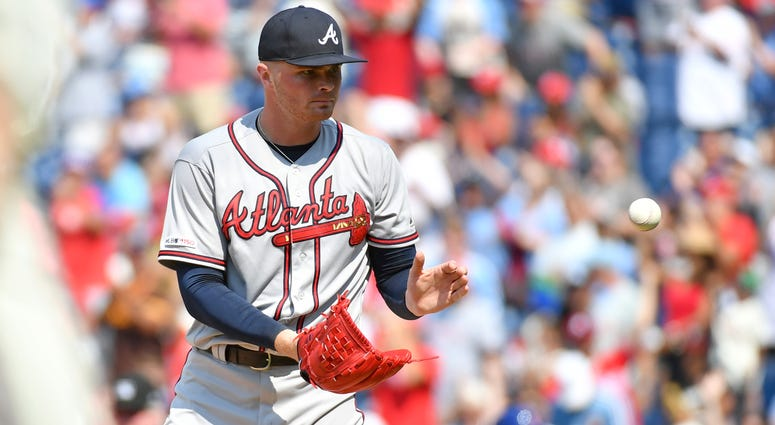 Jul 28, 2019; Philadelphia, PA, USA; Atlanta Braves relief pitcher Sean Newcomb (15) gets a new baseball after allowing a home run during the seventh inning against the Philadelphia Phillies at Citizens Bank Park. Mandatory Credit: Eric Hartline-USA TODAY