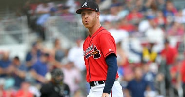 Oct 4, 2019; Atlanta, GA, USA; Atlanta Braves starting pitcher Mike Foltynewicz (26) reacts after the second inning against the St. Louis Cardinals in game two of the 2019 NLDS playoff baseball series at SunTrust Park. Mandatory Credit: Dale Zanine-USA TO