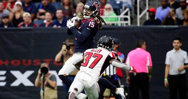 Oct 6, 2019; Houston, TX, USA; Houston Texans wide receiver Will Fuller (15) catches a touchdown pass in front of Atlanta Falcons free safety Ricardo Allen (37) during the first half at NRG Stadium. Mandatory Credit: Kevin Jairaj-USA TODAY Sports