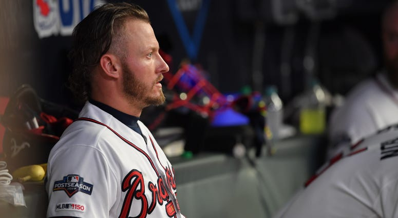 Oct 9, 2019; Atlanta, GA, USA; Atlanta Braves third baseman Josh Donaldson (20) looks out from the dugout during the sixth inning of game five of the 2019 NLDS playoff baseball series against the St. Louis Cardinals at SunTrust Park. Mandatory Credit: Dal