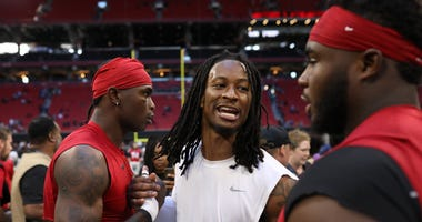 Oct 20, 2019; Atlanta, GA, USA; Los Angeles Rams running back Todd Gurley (center) greets Atlanta Falcons wide receiver Julio Jones (left) and defensive tackle Grady Jarrett (right) after their game at Mercedes-Benz Stadium. Mandatory Credit: Jason Getz-U