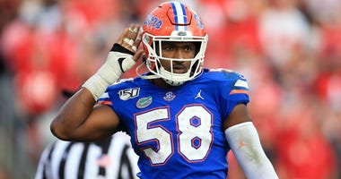 Nov 2, 2019; Jacksonville, FL, USA; Florida Gators linebacker Jonathan Greenard (58) gestures to the crowd against the Georgia Bulldogs at TIAA Bank Field. Mandatory Credit: Matt Stamey-USA TODAY Sports