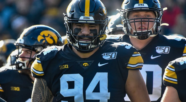 Nov 23, 2019; Iowa City, IA, USA; Iowa Hawkeyes defensive end A.J. Epenesa (94) enters the field before the game against the Illinois Fighting Illini at Kinnick Stadium. Mandatory Credit: Jeffrey Becker-USA TODAY Sports