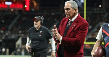 Nov 28, 2019; Atlanta, GA, USA; Atlanta Falcons owner Arthur Blank, right, and head coach Dan Quinn reacts to a play in the second half during the Atlanta Falcons' game against the New Orleans Saints at Mercedes-Benz Stadium. Mandatory Credit: Jason Getz-