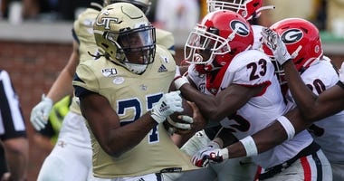 Nov 30, 2019; Atlanta, GA, USA; Georgia Tech Yellow Jackets running back Jordan Mason (27) is tackled by Georgia Bulldogs defensive back Mark Webb (23) in the second half at Bobby Dodd Stadium. Mandatory Credit: Brett Davis-USA