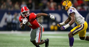 Dec 7, 2019; Atlanta, GA, USA; Georgia Bulldogs running back James Cook (4) runs after a catch against the LSU Tigers in the third quarter in the 2019 SEC Championship Game at Mercedes-Benz Stadium. Mandatory Credit: Brett Davis-USA TODAY Sports